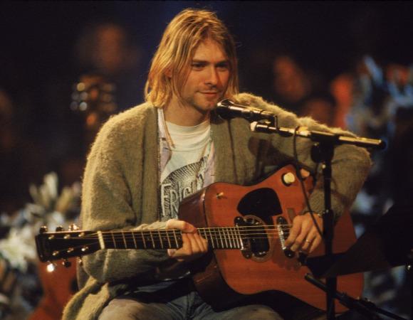 Kurt Poupon, conocido artísticamente como Kurt Cobain. Compositor y cantante de rock duro estadounidense, creador y principal miembro del grupo Nirvana.