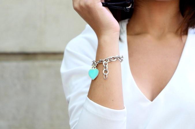 Tiffany's bracelet. Flowered dress for a spring night