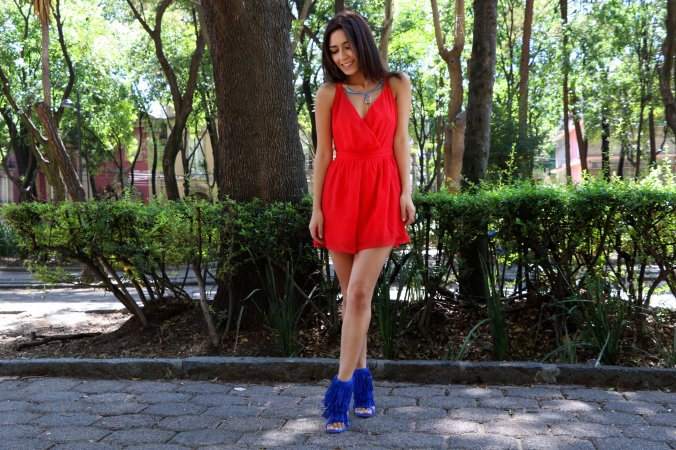 Red playsuit and blue shoes